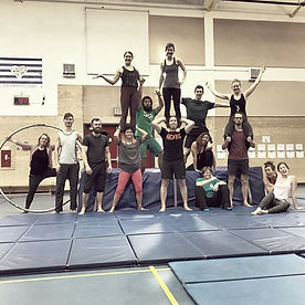 a group of friends train together at open training at island circus space in victoria BC