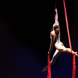 Coral Crawford performs on the aerial silks. Learn how to be an aerialist too at island circus space in victoria BC