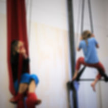 kids summer circus camps in aerials, juggling, silks, partner acrobatics, balancing, tumbling and more!