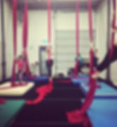students practice aerial silks at a class at island circus space in victoria BC