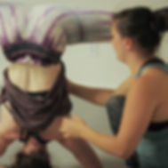 circus instructor teaches a student in handstand class at island circus space