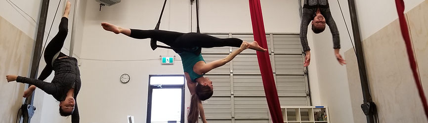 aerialists at island circus space where you can learn circus too!