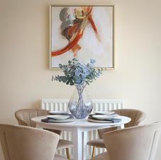 Striking, modern artwork and mirrors