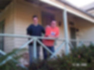 Image of - Cameron Skinner with houemate on their verandah