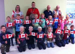 Grade 1 Student receive flags