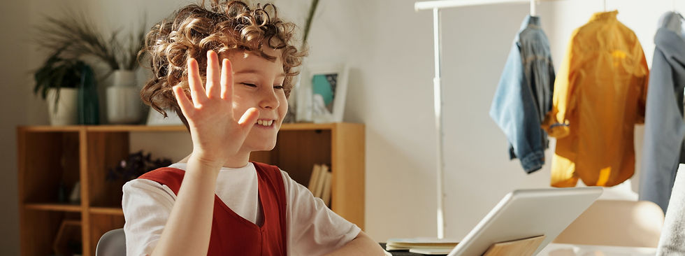 photo-of-child-smiling-while-using-table
