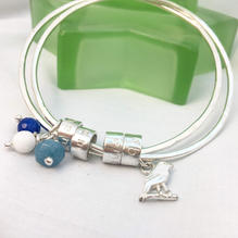 Family bangle with bespoke canary charm