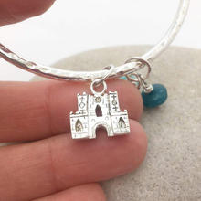 Message bangle with bespoke charm of Abbey ga