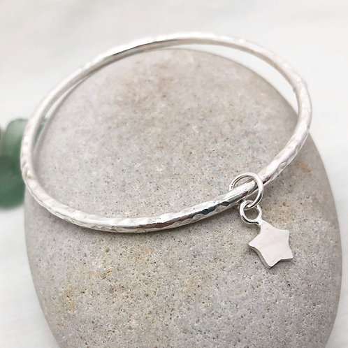 hammered bangle with star charm