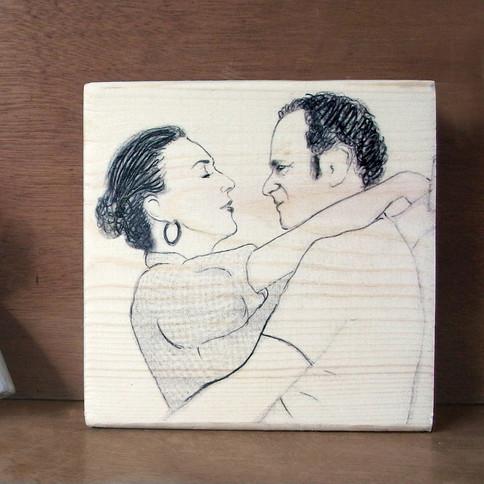 איור של זוג על בלוק עץ
