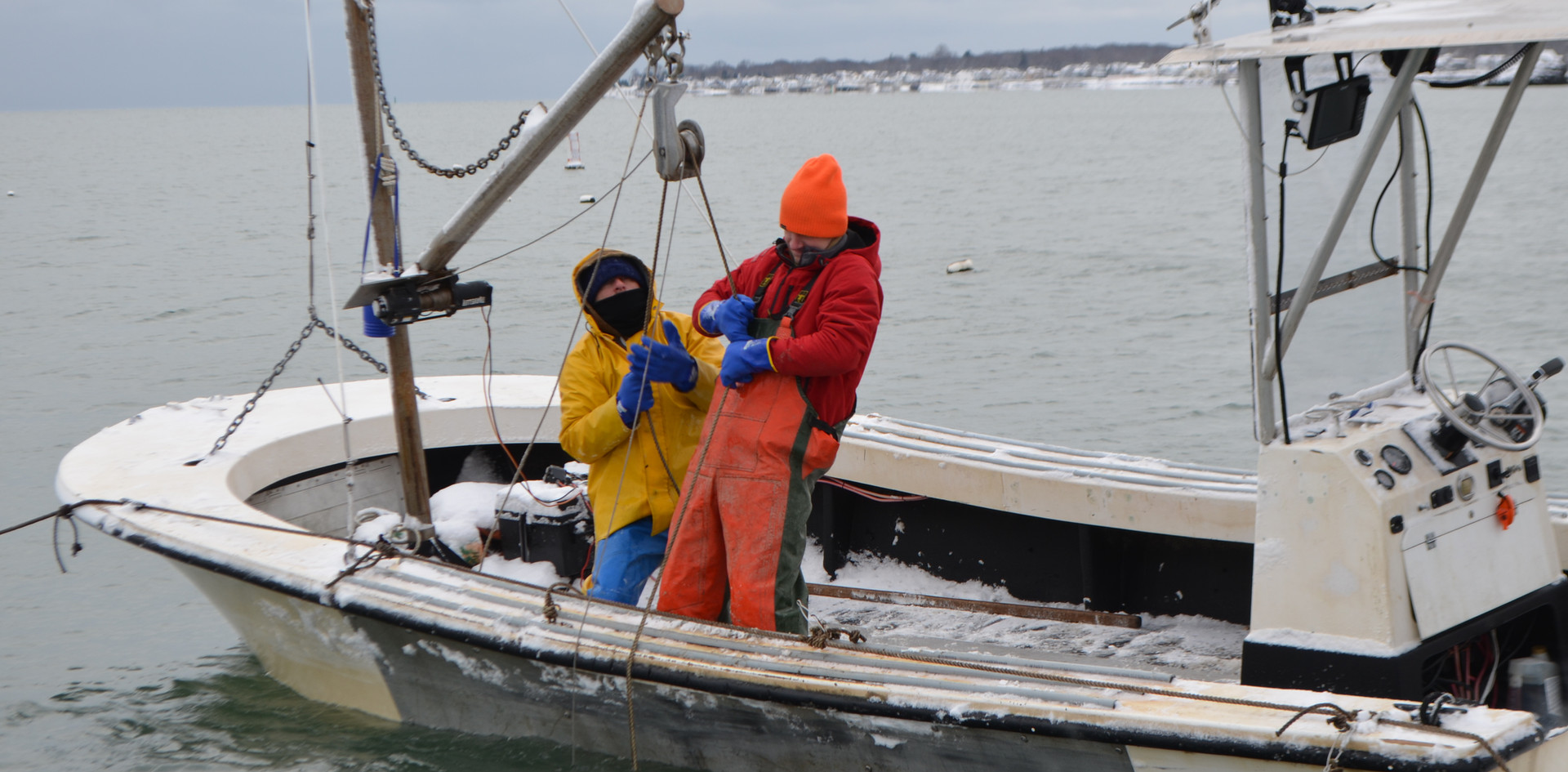 Tim and Dana Hauling in Oysters