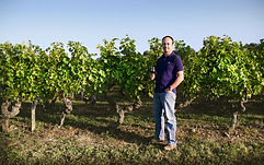 dozon winemaker with vines.PNG