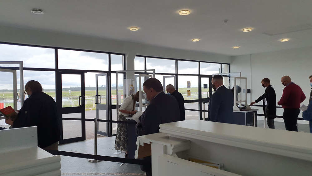 Socially distanced racegoers at the Curragh's first fixture open to the public