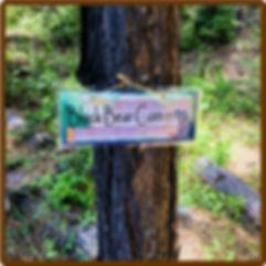 Black Bear Corner Camping Sign Image May