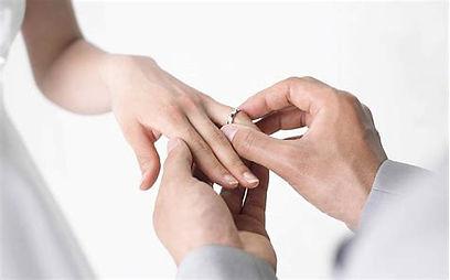 placing wedding ring.jpg