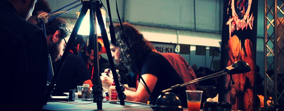 "Matteo ""Durgin"" Donzelli, founder of Durgin Paint Forge, during a painting demo in Lucca Comics&Games"