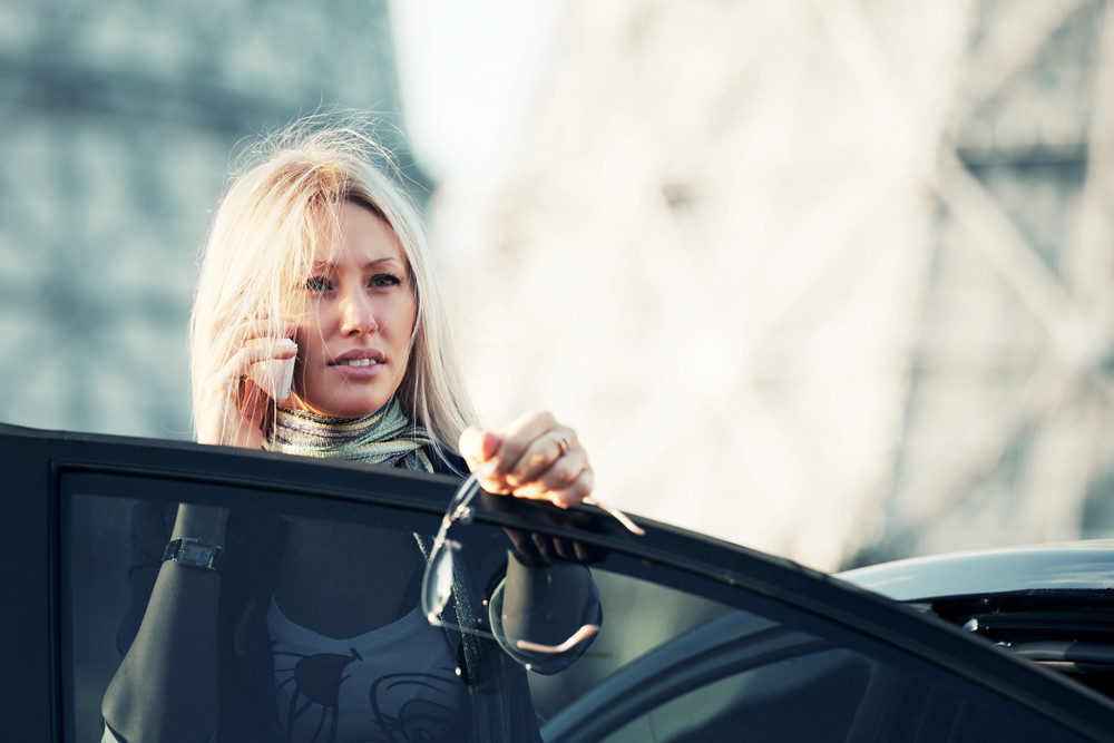 woman on phone with friends or family reach out