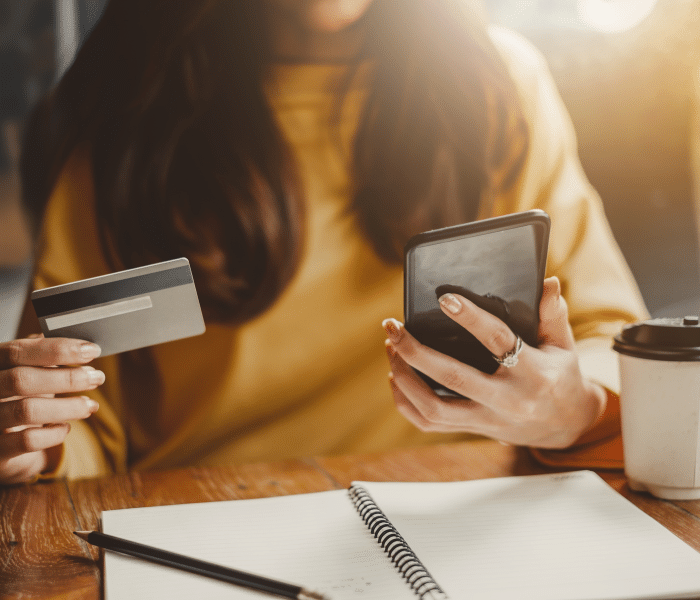 Woman shopping online via a phone