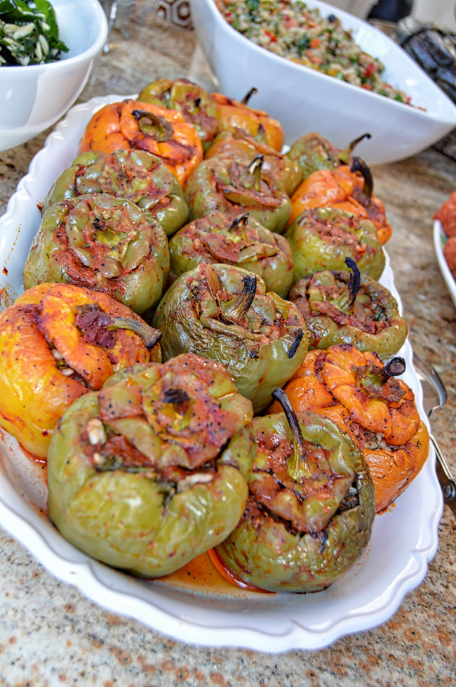 OVEN ROASTED HERB AND RICE STUFFED BELL PEPPERS WITH A TOMATO SAUCE