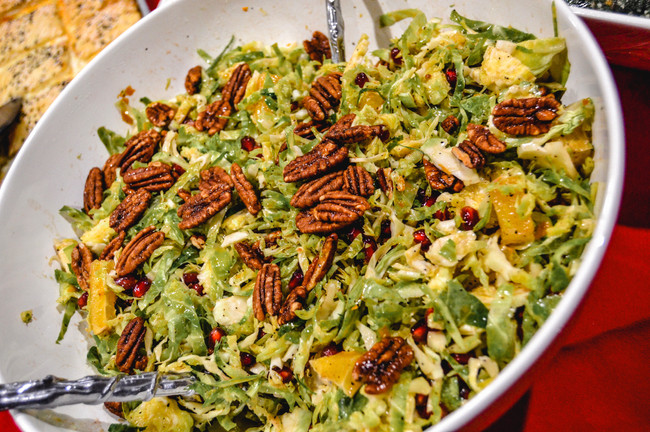 BRUSSELS SPROUTS SALAD WITH POMEGRANATE ORANGE VINAIGRETTE AND PECANS