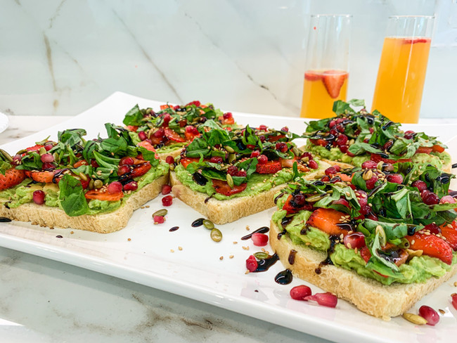 AVOCADO TOAST WITH STRAWBERRIES AND POMEGRANATES