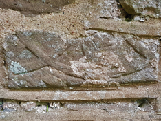Welsh Newton, stone carved fish on exter