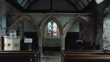 Welsh Newton, view of stone rood screen.