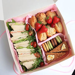 Afternoon Tea box available for 2 or more people. It comes with Tea Sandwiches, Freshly made scones and variety of desserts.