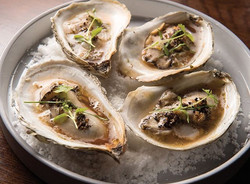 Wood grilled local oysters with foraged