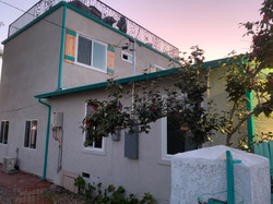 grey house with green gutters