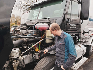 Colin_looking_at_truck.jpg