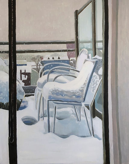 A balcony is covered in a blanket of snow with lawn chairs and distant houses