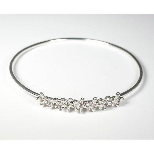 Daisy bangle with white topaz gemstones
