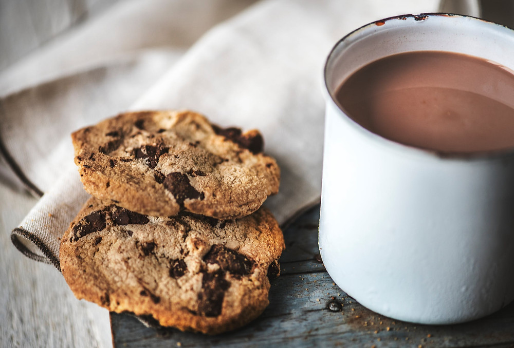 Cozy mug of hot cocoa and cookies feels like hygge