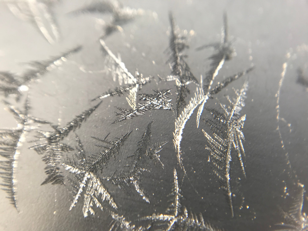 Macro photography image of frost on a window during winter