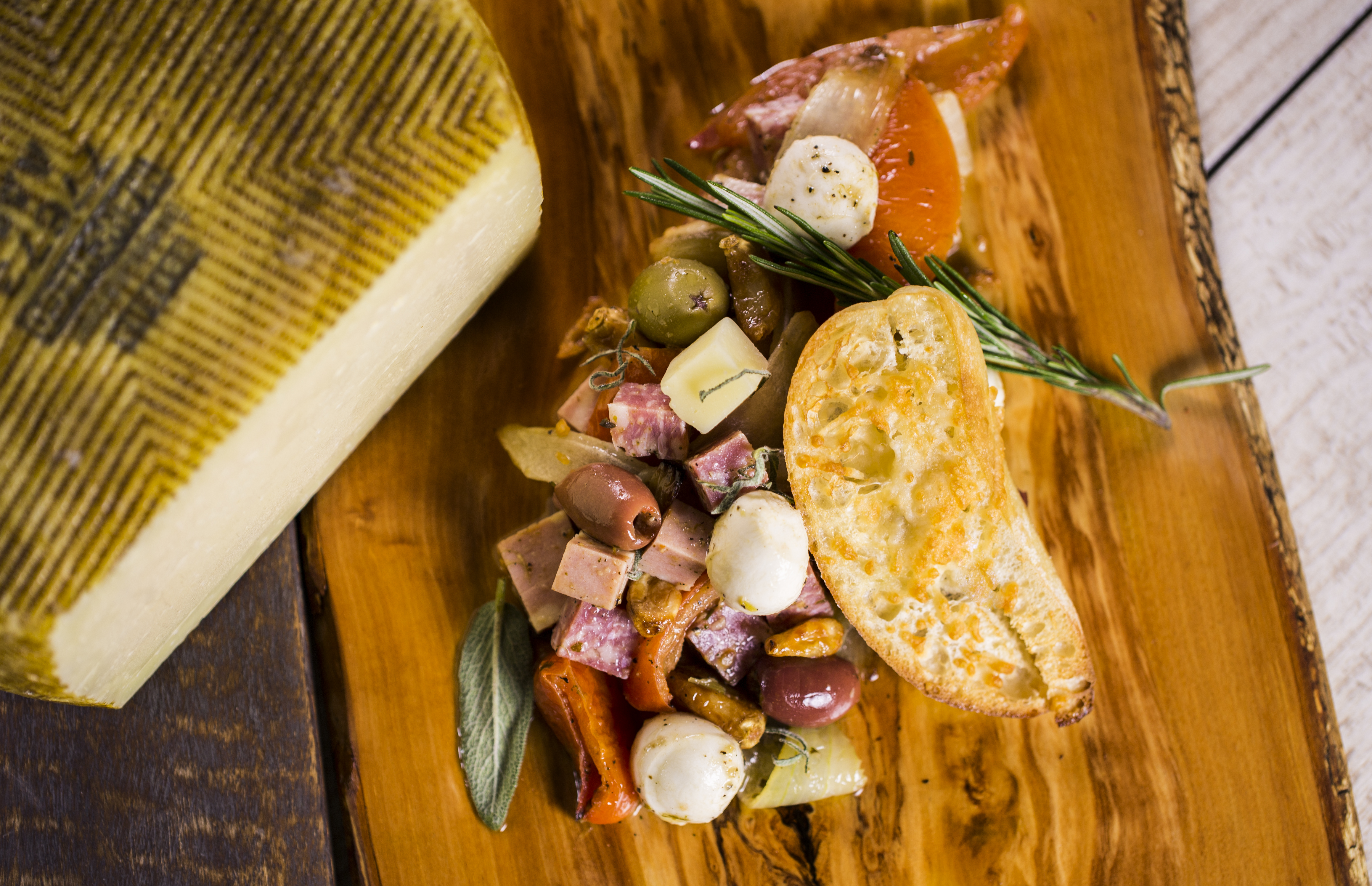 Anitpasti of roasted tomatoes, artesian meats, cheese, olives