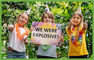 kids pose with escape room poster