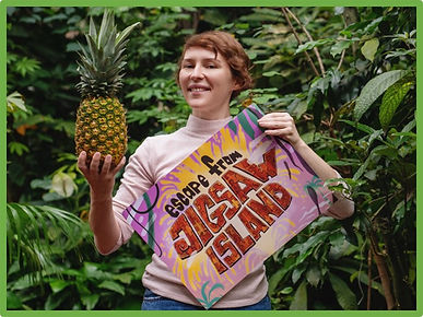 adult poses outside with escape room poster and pineapple