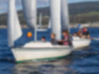 Take part in competitive sail racing