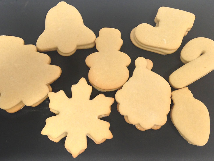 Plain Christmas cookies ready to decorate