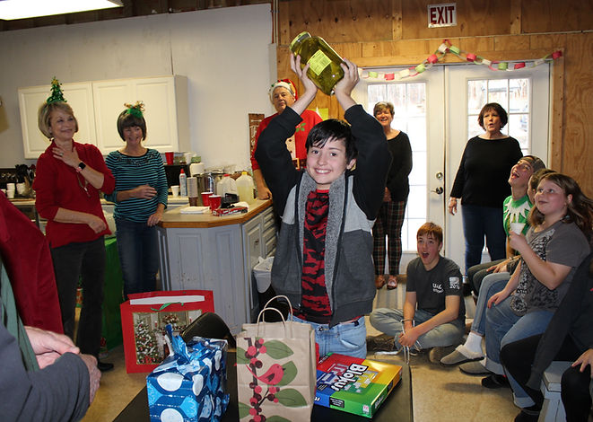 cowboy kids gift giving at Christmas event