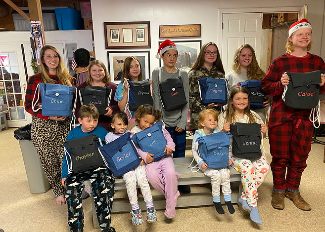 cowboy kids receive bookbags and school supplies
