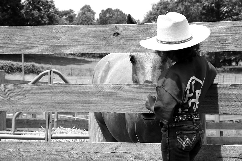 cowboy kid doing equine therapy