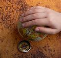 Canva - Hand Holding Mini Globe Beside a Compass.jpg