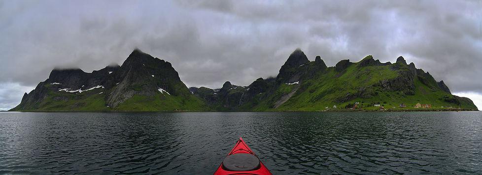Sea kayaking in Reinefjorden, Lofoten Islands, Norway