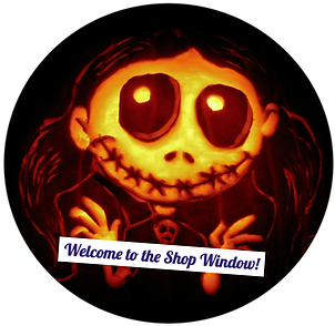 "Image of a Skull-like girl carved into a pumpkin with the words ""Welcome to the Shop Window"""