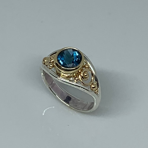 Sterling Silver and14k Yellow Gold Blue Topaz Ring