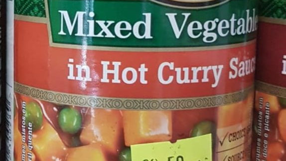 KOO Mixes Vegetables in Hot Curry Sauce