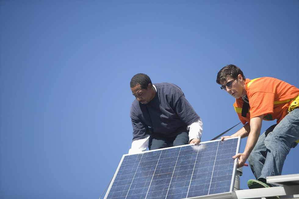 Low angle view of engineers fixing solar panel against blue sky.jpg