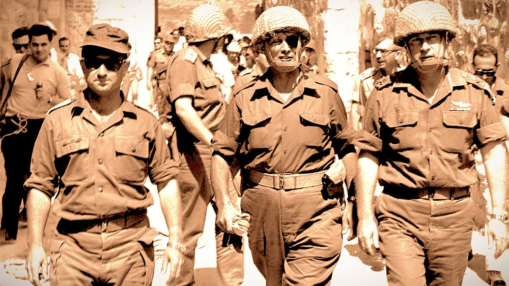Illustration: Yitzhak Rabin, Moshe Dayan and Uzi Narkiss (r. to l.), Old City of Jerusalem, Six Day War, by Ilan Bruner (אילן ברונר)/Government Press Office of Israel under the digital ID D327-039 [CC BY-SA 3.0] via Wikimedia